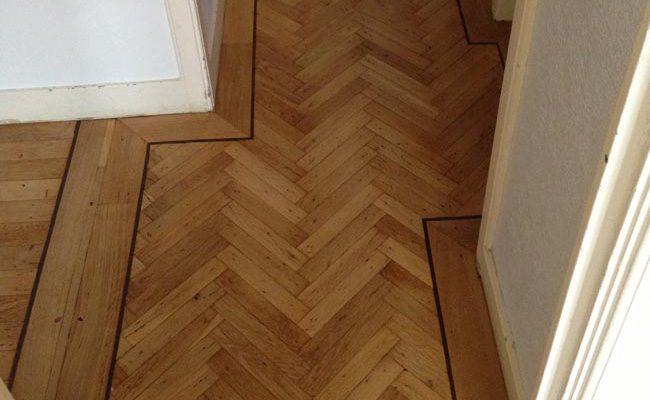 kleine-visgraat-dubbele-band-bies-houten-vloer-amsterdam-2
